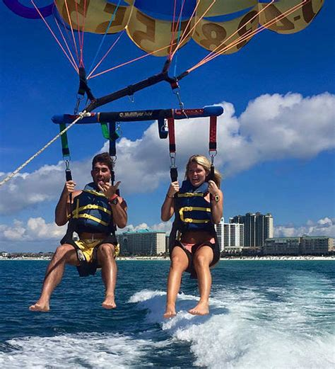 Parasailing in Destin behind Pompano Joe's Seafood in