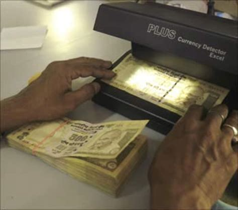 Fake currency problem is alarming: FM - Rediff